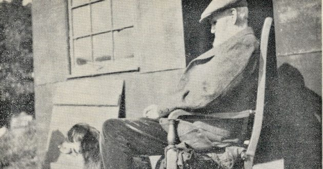 Old photograph of Peter Woods in a rocking chair outside his home.
